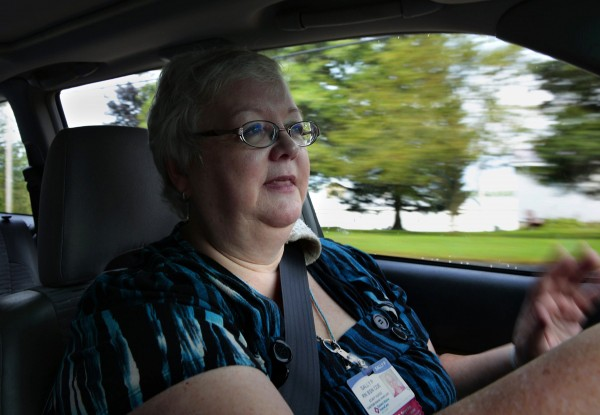 Nurse Sally Patterson, of Eastern Maine Homecare, drives to her home visit in Bangor, Maine, Sept. 12, 2013.