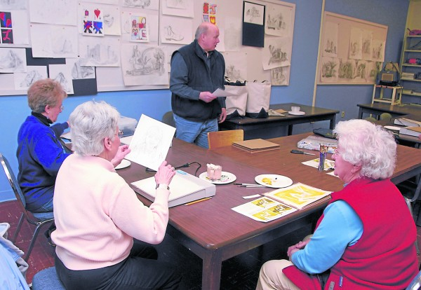 "Lincoln artist David Whalen teaches a Penobscot Valley Senior College class in watercolor painting at Eastport Hall on the University of Maine at Augusta-Bangor campus in March 2013. Whalen will offer his ""Learn to Paint with Watercolors"" during the PVSC's spring 2014 program; his class will be taught at Hobby Lobby on Stillwater Avenue in Bangor."