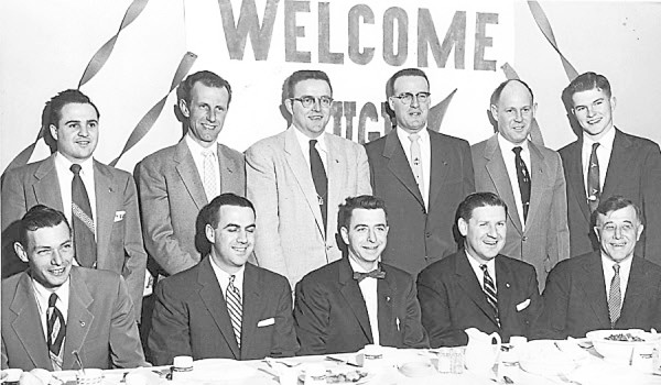 The Orono Junior Chamber of Commerce staged a banquet on Feb. 29, 1956, in honor of National Jaycee President Hugh McKenna of Nebraska. Among the participants were (seated, from left) Maine Jaycee Vice President Frederick M. Woodman; professor Gerald Grady, University of Maine, one of the Jaycees' three Outstanding Young Men of Maine for 1955; Maine Jaycee President Thomas C. Rice, Hampden; McKenna; University of Maine President Arthur A. Hauck; (standing) Maine Secretary Raymond Fournier, Bangor; National Jaycee Director for Maine C. Ivan Tozier, Skowhegan; National Director Linwood Pelletier, Presque Isle; Maine Vice President Richard Small, Orono; Orono Jaycee President Stephen MacPherson; and National Jaycee Teen-Age Rodeo Chairman William Leger, Portland and University of Maine.