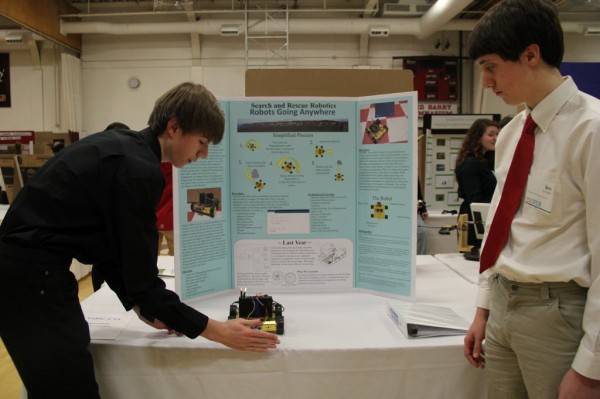 Justin Hamilton and Ben Schade, sophomores at the Maine school of Science and Engineering, presented a robot they had built for the Maine State Science Fair. The robot can detect obstacles and navigate around them.