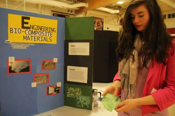 Willa Thompson, a Bangor High School freshman, presenter her research on the possibility of using invasive plants to make paper products at the Maine State Science Fair.