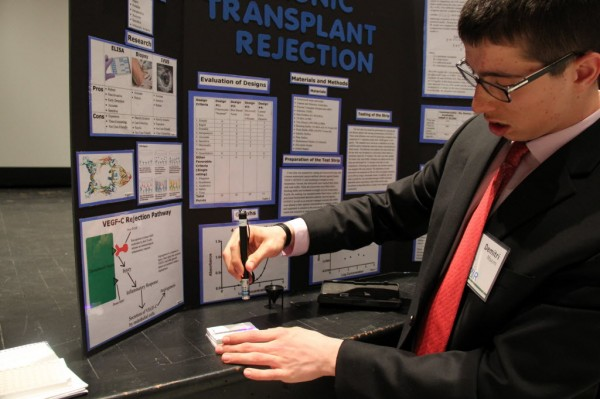 Dimitri Maxim demonstrated his invention at the Maine State Science Faire on Saturday. The device can detect protein in the blood in order to predict whether a body is rejecting a transplant.