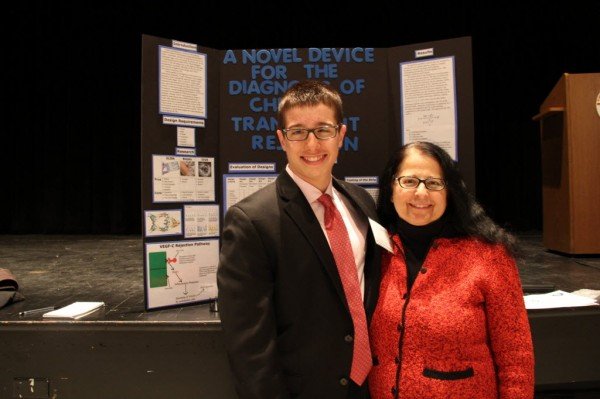 Dimitri Maxim and his mother Lefki Michael-Maxim at the Maine State Science Fair. Dimitri won the science fair for an invention he was inspired to create after his mother received a kidney transplant.