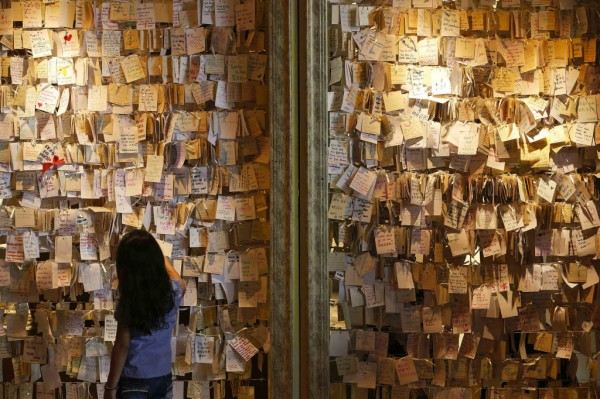 A girl reads some of the messages of hope and support for the passengers of the missing Malaysia Airlines MH370 at a mall outside Kuala Lumpur on Saturday.