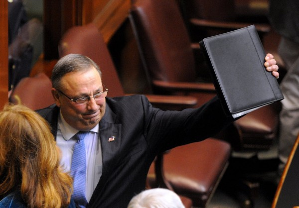 Gov. Paul LePage waves as he leaves the House of Representatives chamber after he delivered his 2014 State of the State address at the State House in Augusta in this February 2014 file photo.