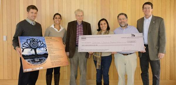 GreenWood Founder Scott Landis, and his Honduran colleague Yadira Molina (holding check), received the Yale Innovation Prize from Peter Pinchot (center) and Tim Northrop (far right) of Yale. Conference chairs, Matt Bare and Desirée Lopes, are at left.