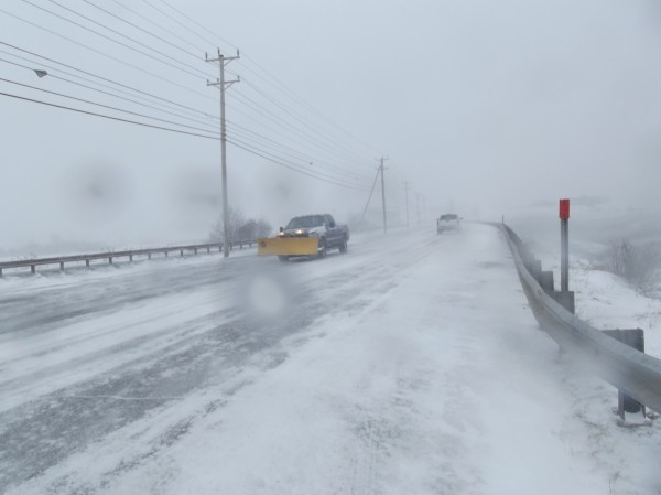 Traffic crosses U.S. 1 on the dike across the Middle River in Machias on Wednesday afternoon while the opposite side is scarcely visible because of blizzard conditions.