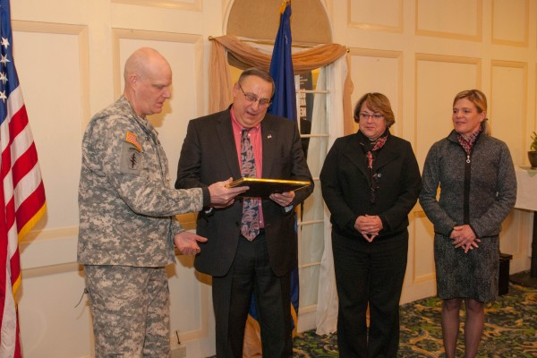 Brig. Gen. James Campbell, the Adjutant General, presents Gov. Paul R. LePage, Anne Head, Commissioner of the Department of Professional and Financial Regulation, and Board Administrator Catherine Carroll with ESGR Seven Seals awards.