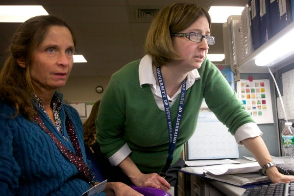 Dr. Tammi Schaeffer (right) and poison specialist Tami Perron look over the follow-up on a case at the Northern New England Poison Center in Portland recently. The staff at the center often stay in touch with callers to make sure their information and medical needs are met.