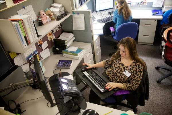 Poison specialists Shannon Smith (left) and Tami Perron take calls at the Northern New England Poison Center in Portland recently. The call center covers Maine, New Hampshire and Vermont.