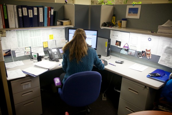 Poison specialist  Tami Perron takes calls at the Northern New England Poison Center in Portland recently. The call center covers Maine, New Hampshire and Vermont.