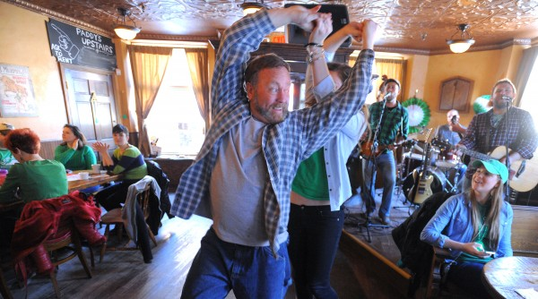 Kris Nelson of Ellsworth and Katie Lavery of Bangor dance as people celebrate Saint Patrick's Day at Paddy Murphy's in Bangor Friday morning.  The Bangor-based band Bar Stuards started playing at 6 a.m. kicking off the all day live music at the pub.