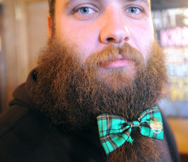 Phill Carter, a bouncer at Paddy Murphy's, spruced up his attire  as he was working on Saint Patrick's Day at the bar in Bangor Friday morning.