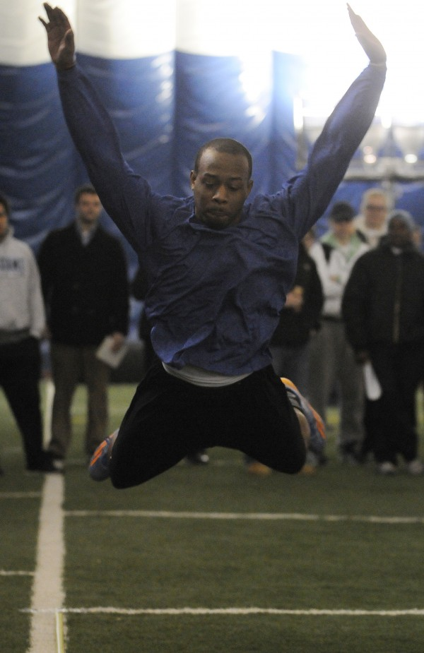 UMaine football player Jamal Clay participates in the broad jump for NFL scouts during pro day at the University of Maine on Monday.