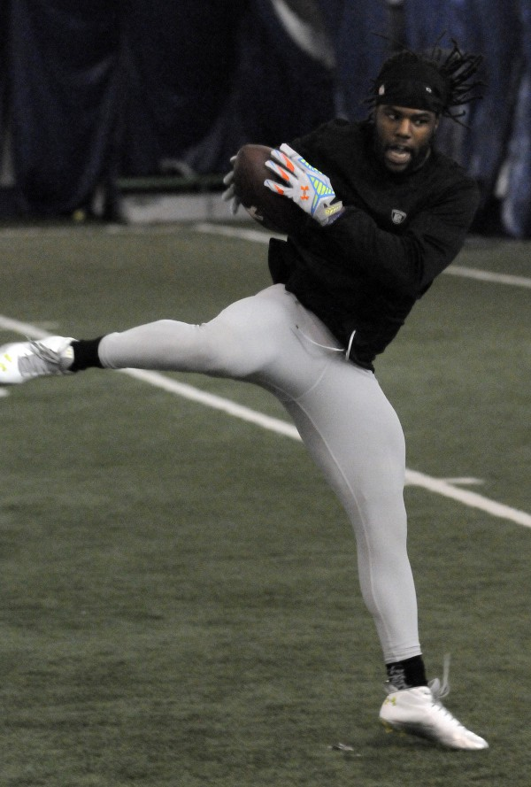 UMaine football player Trevor Coston snags a catch as NFL scouts watch during pro day at the University of Maine on Monday.