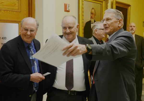 State Rep. Roger Reed, R-Carmel, left, shares a laugh with State Finance Commissioner Sawin Millett, center, and state Rep. Tom Winsor, R-Norway. Millett, of Waterford, is retiring from his post and was lauded in speeches on the House Floor Monday for his 55 years of service to the state as both government official and state lawmaker. Joining him were members of his family and his wife Barbara, who also received accolades for her years of support.