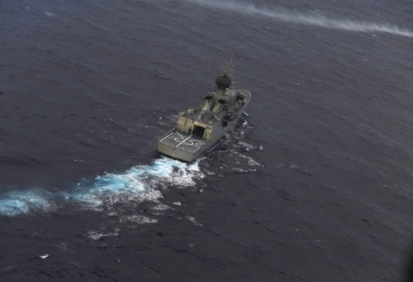 The Royal Australian Navy ship HMAS Perth is guided into position by a Royal New Zealand Airforce (RNZAF) P-3K2 Orion aircraft to recover an object in the southern Indian Ocean, as the search continues for missing Malaysian Airlines flight MH370 on April 13, 2014.