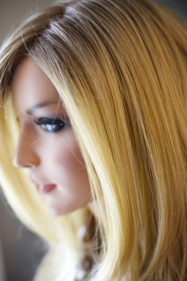 Charlene Boggins of Veazie shows one of her wigs at her salon, Nourish Salon, where she works with women going through cancer treatment and facing hair loss.
