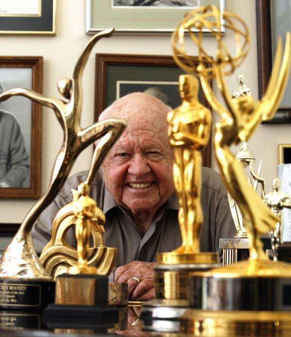 Actor Mickey Rooney smiles in front of his trophies during an interview with Reuters at his home in Westlake Village, California in February 14, 2007.