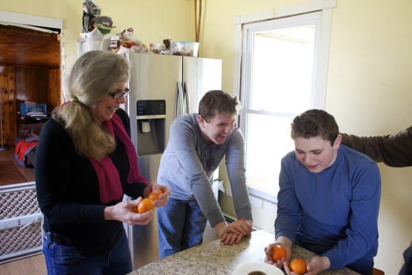 Richmond mother Kathleen Leopold (from left) juggles nectarines with her two sons Sam Hadjaissa, 15, and Oscar Hadjaissa, 13.