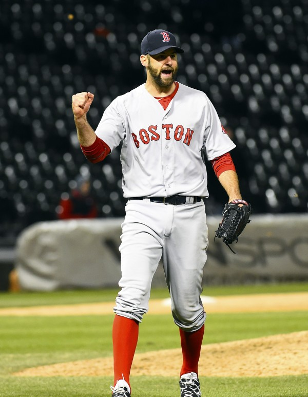 Boston Red Sox relief pitcher Burke Badenhop (35) reacts after getting the save at U.S Cellular Field in Chicago Wednesday night. Boston beat Chicago 6-4 in 14 innings.