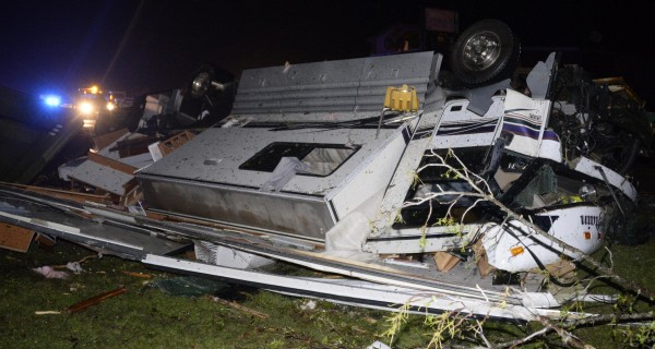 An overturned vehicle is seen amid debris after a tornado hit the town of Mayflower, Arkansas around 7:30 p.m. April 27, 2014.