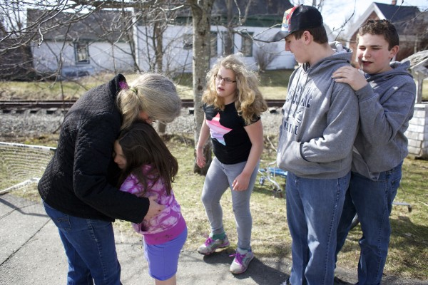 Richmond mother Kathleen Leopold (from left) hugs her daughter Zoe Hadjaissa, 8, while playing outside with her other children Lily, 10, Sam, 15, and Oscar Hadjaissa, 13. Leopold has four children, three of whom are autistic. Leopold recently had one of her stories published in a &quotChicken Soup&quot book. She also blogs about her life as a mom to several children with autism.