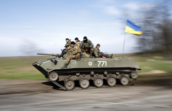 Ukrainian soldiers drive an airborne combat vehicle near Kramatorsk, in eastern Ukraine April 16, 2014. Ukrainian forces tightened their grip on the eastern town of Kramatorsk on Wednesday after securing control over an airfield from pro-Russian separatist militiamen, prompting Russian President Vladimir Putin to warn of the risk of civil war.