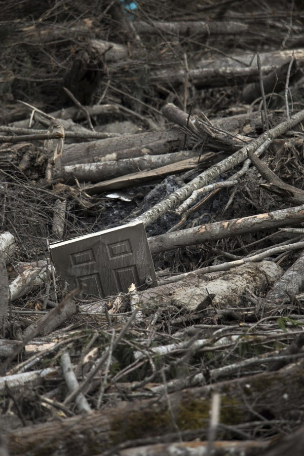 A door is seen trapped amidst a debris field left by a mudslide in Oso, Washington, April 3, 2014.