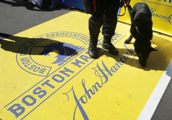 Boston Police dog &quotTitan&quot and his handler Officer Joel Rodriguez patrol the finish line of the Boston Marathon in Boston, Massachusetts April 20, 2014.