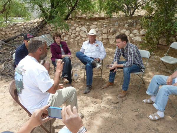 Nevada rancher Cliven Bundy (center) talks with supporters outside his ranch on April 22, 2014. The family has been giving daily news conferences since the conflict between Bundy and the federal Bureau of Land Management.