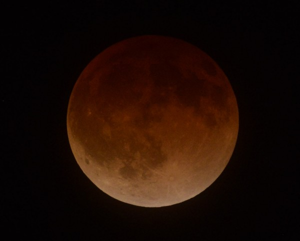 The moon is shown in its final eclipse over Los Angeles, California, early April 15, 2014. The lunar eclipse unfolded over three hours, when the moon began moving into Earth's shadow. A little more than an hour later, the moon could be seen eclipsed and bathed in an orange, red or brown glow.