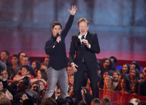 Host Conan O'Brien (R) performs a song with Adam DeVine at the 2014 MTV Movie Awards in Los Angeles, California on April 13, 2014.
