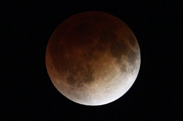 A shadow falls on the moon as it undergoes a total lunar eclipse as seen from Mexico City April 15, 2014.