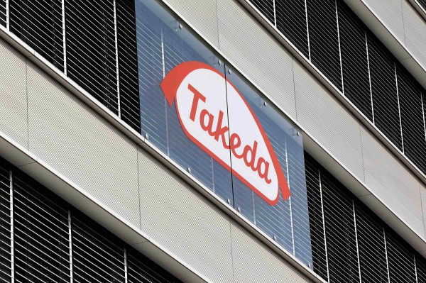 The logo of Japanese Takeda Pharmaceutical Co is seen at an office building in Glattbrugg near Zurich, in this March 7, 2012 file photo.