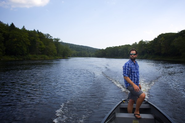 Lucas St. Clair steers a square stern canoe on the East Branch of the Penobscot River into an area where Elliotsville Plantation Inc. has opened 40,000 acres to hunting and other recreational use.