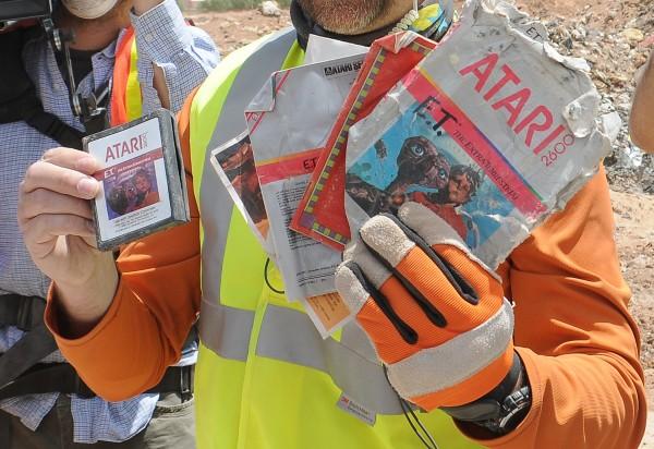 A worker shows the media the first recovered &quotE.T. the Extra-Terrestrial&quot cartridge at the old Alamogordo landfill in Alamogordo, New Mexico, April 26, 2014.