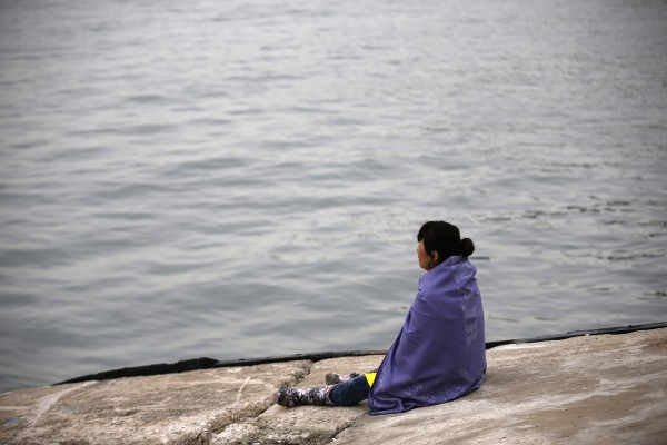 A family member of a missing passenger who was on the South Korean ferry Sewol, which capsized on Wednesday, looks at the sea while waiting for news from a rescue team, at a port in Jindo on Saturday.