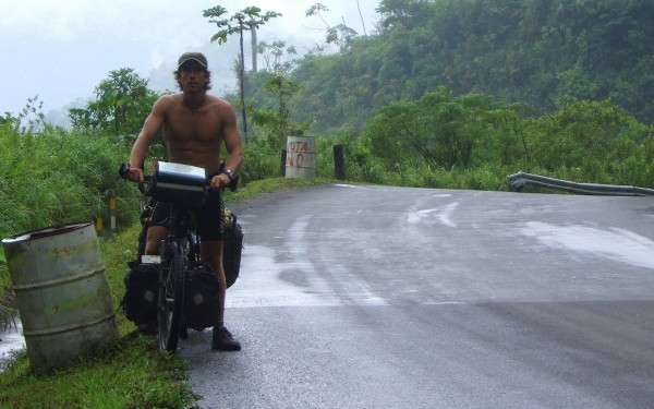 Adventurer and filmmaker Dominic Gill takes a break while biking the humid hills of Panama in 2006 during his Take A Seat bike tour from Alaska to Argentina.