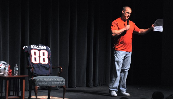 Enfield native Matt Mulligan, formerly of the New England Patriots, speaks to students at Husson University's Gracie Theatre on March 24.