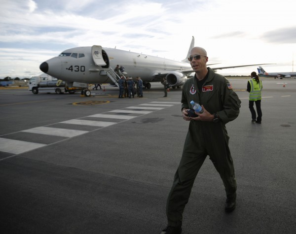 A U.S. Navy P8 Poseidon aircraft pilot, Lt Commander David Mims is pictured in front of the plane upon his return from a search flight for Malaysia Airlines flight MH370 over the Indian Ocean, at Perth International Airport March 31, 2014.