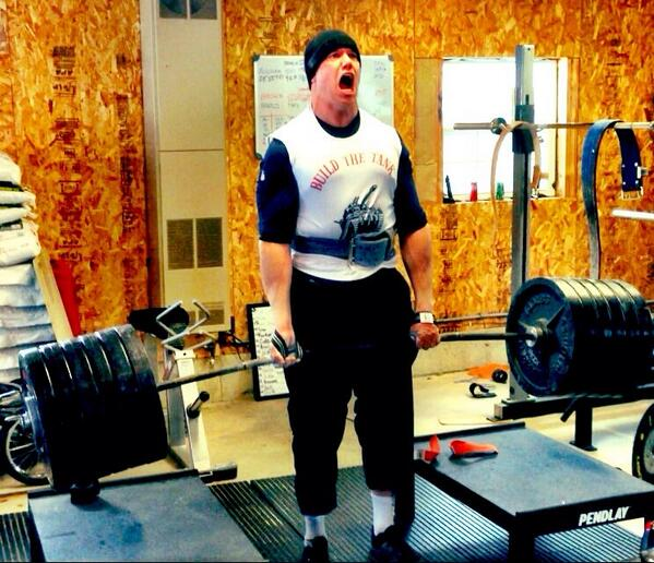 Enfield native Matthew Mulligan strains as he hoists 730 pounds while performing a rack pull during a recent workout. Mulligan, who spent last season with the New England Patriots, is trying to earn a spot on an NFL roster again in 2014.