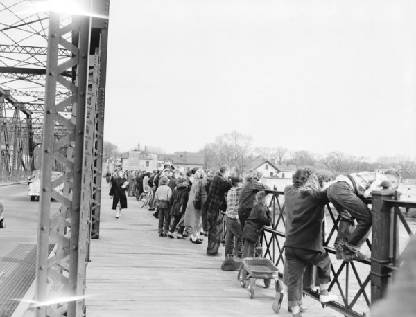 Onlookers lined up along the old Bangor-Brewer bridge trying to get a glimpse of the whales that wandered up the Penobscot River to Bangor on April 26, 1954.