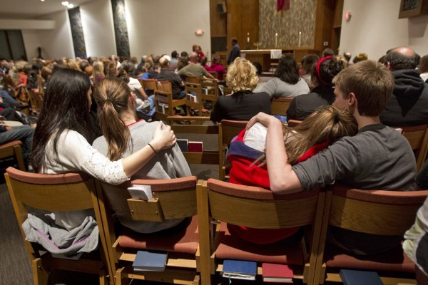 People, including many students from Blue Valley High School, gathered to mourn the victims of the shooting at the Jewish Community Center and Village Shalom during a vigil at St. Thomas The Apostle Episcopal Church in Overland Park, Kan., Sunday, April 13, 2014.
