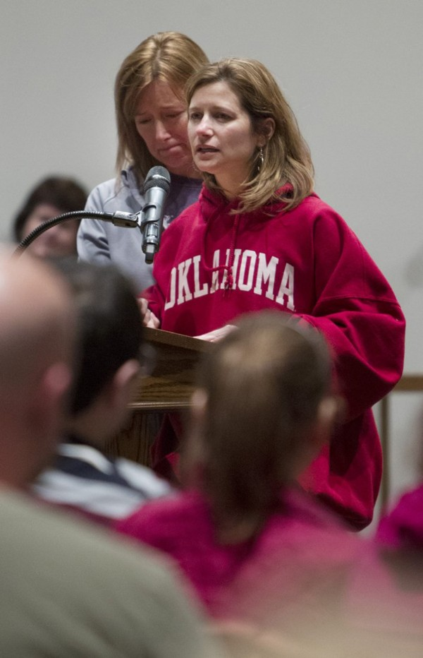 Mindy Corporan, right, mother of murder victim Reat Underwood, who was killed in a shoot at the Jewish Community Center in Overland Park, Kan., speaks during a vigil held to mourn the victims at St. Thomas The Apostle Episcopal Church in Overland Park, Sunday, April 13, 2014.