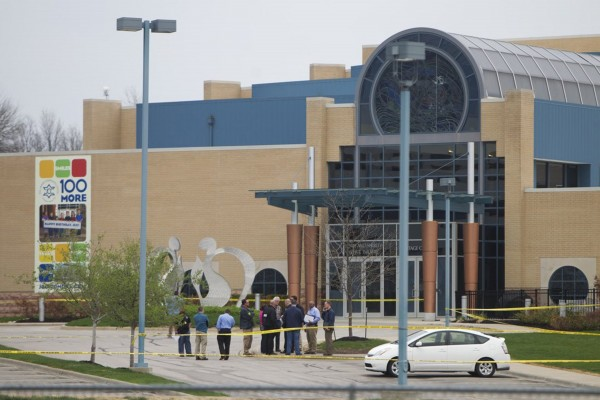 Police appear on the scene of a shooting at the Jewish Community Center campus in Overland Park, Kan., Sunday,