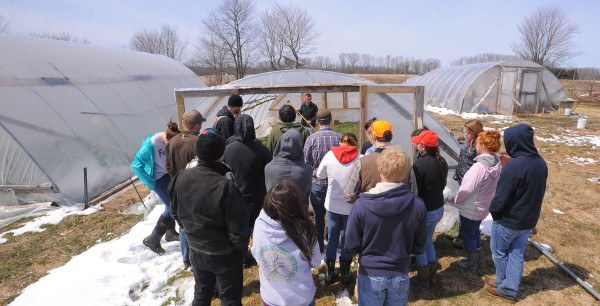 A group of Brewer High School students check out one of the greenhouses at the Parker Family Farm in Newport on Thursday. Thirty students came to visit the farm as part of their environmental issues class. The students came to see how a small farm using sustainable agricultural methods is run.