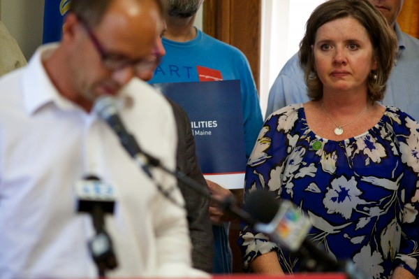 Jackie Barden listens to her husband Mark speak at Portland City Hall on July 6, 2013 as he called for expanded background checks for prospective gun buyers. The Barden's son, Daniel, was one of 20 first-graders murdered  at Sandy Hook Elementary School in Newtown, Conn.