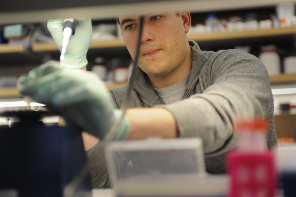 Joe Zak, a research assistant at Jackson Laboratory in Bar Harbor, uses a pipette and a centrifuge to find genes of interest in DNA sequences while working in Dr. Zhong Wi Zhang's lab Feb. 2, 2010.