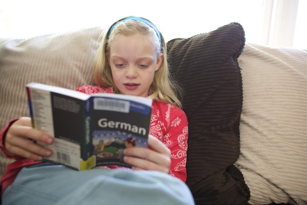 Megan, 8, looks over a German language book in her Orono home on Tuesday. She has been studying for a future trip to Austria her family will be making.